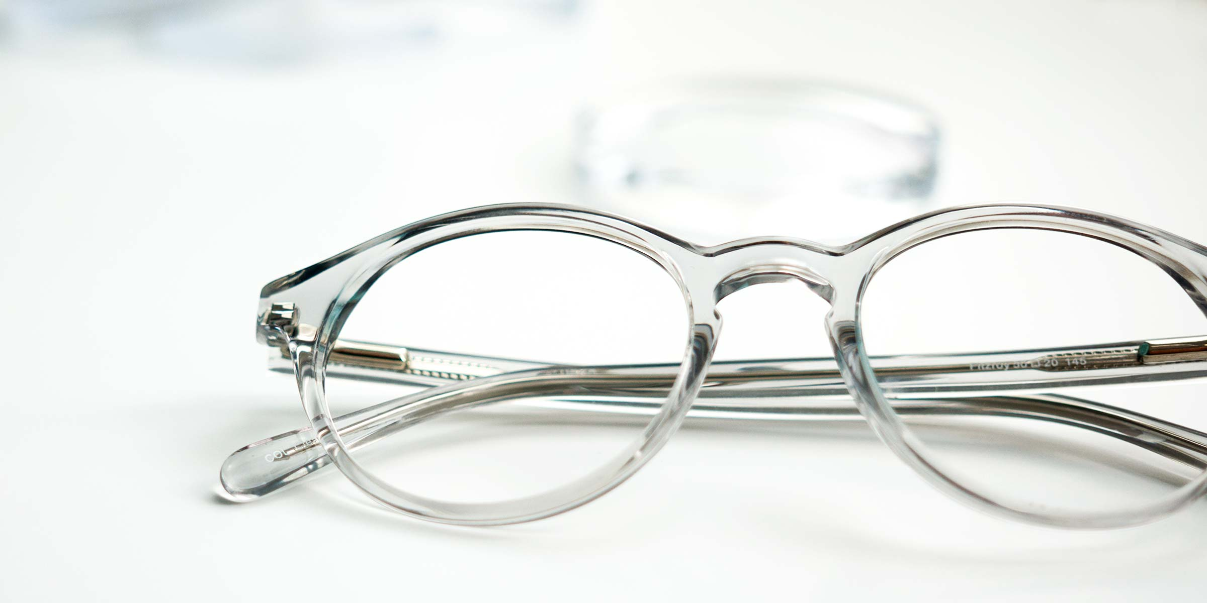 A transparent glasses frame