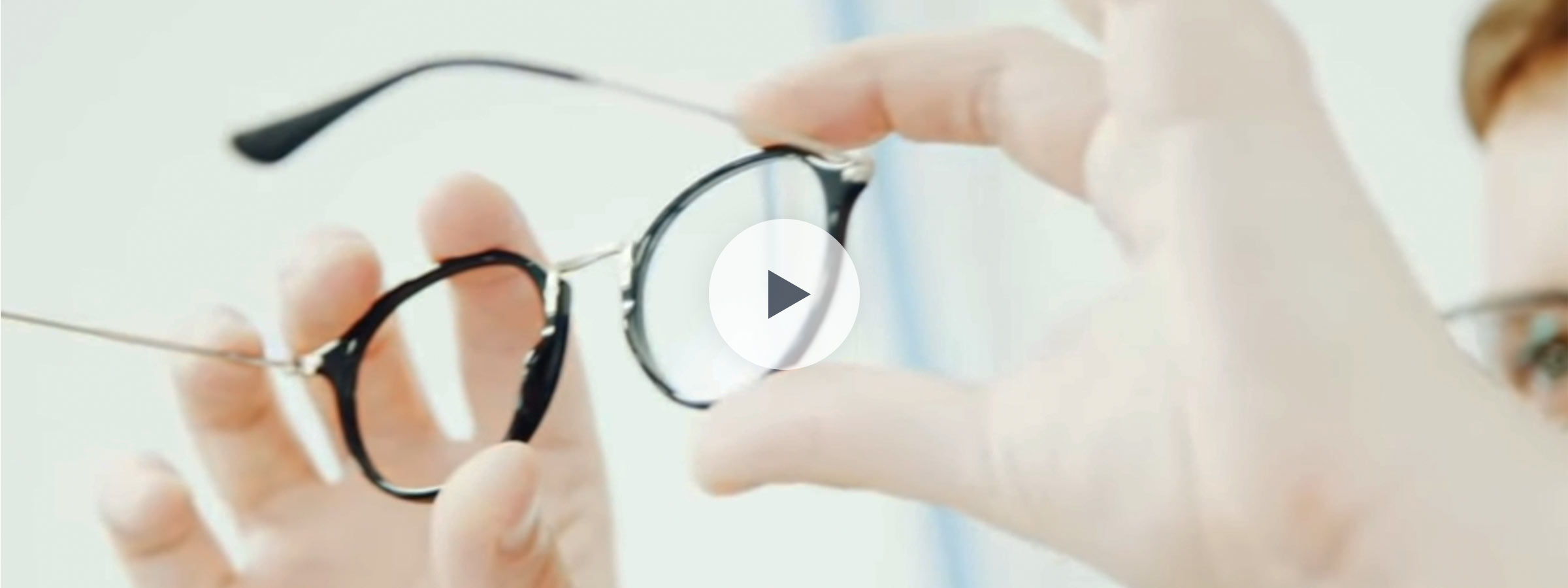 A pair of glasses being held up for inspection