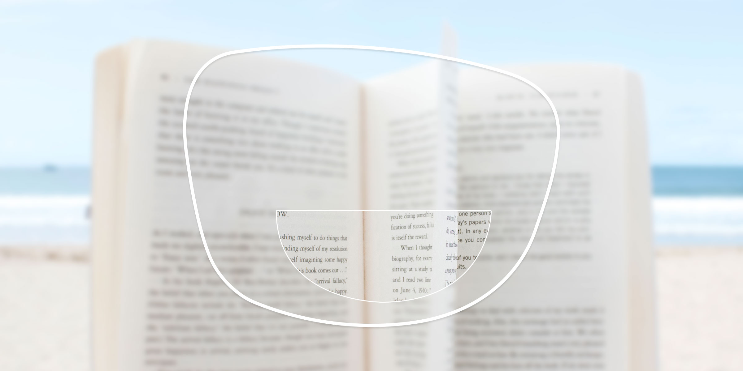 A book viewed through a bifocal lens, with only the reading segment in focus