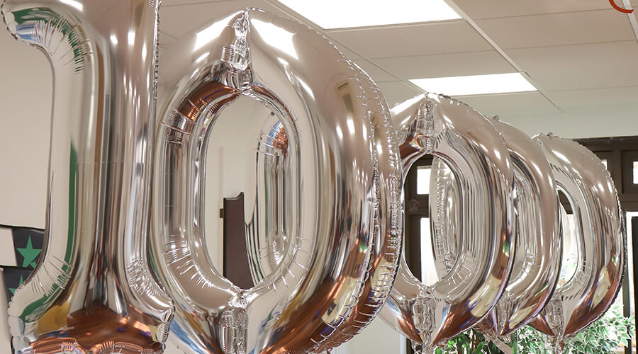 Balloons spelling out the number 100,000