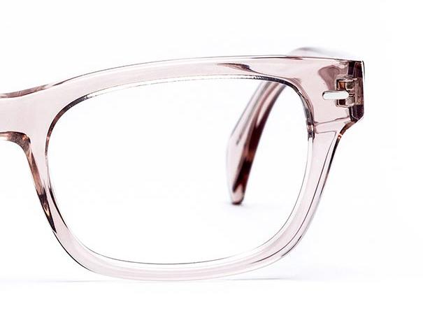Half a pair of pastel pink glasses
