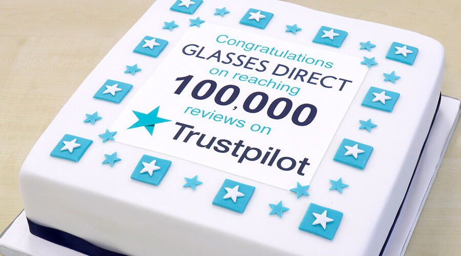 A cake with the words: Congratulations Glasses Direct on reaching 10,000 reviews on Trustpilot