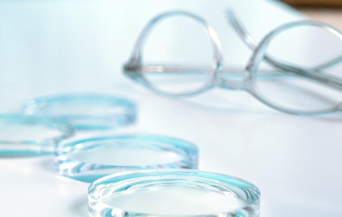 Glasses lenses lying next to a frame