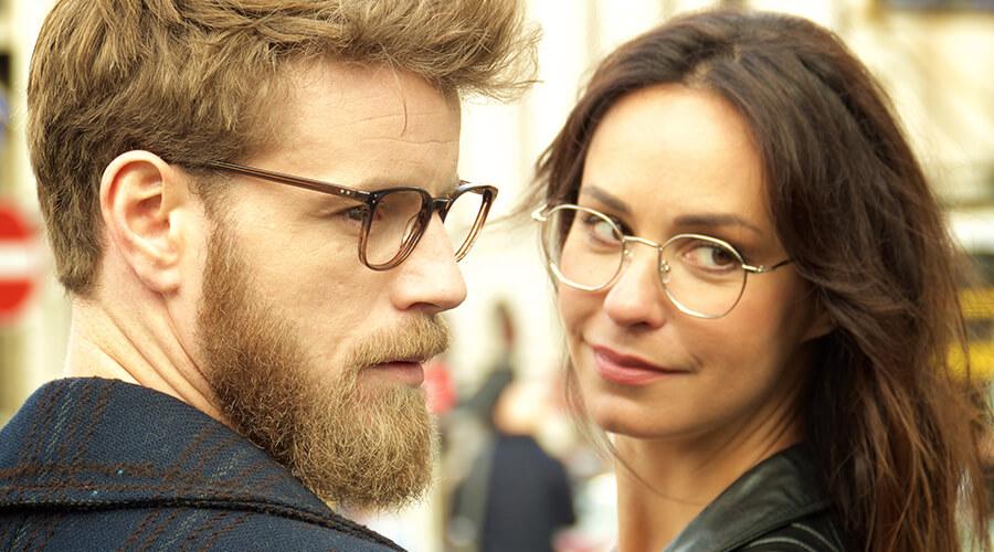 Couple wearing London Retro glasses