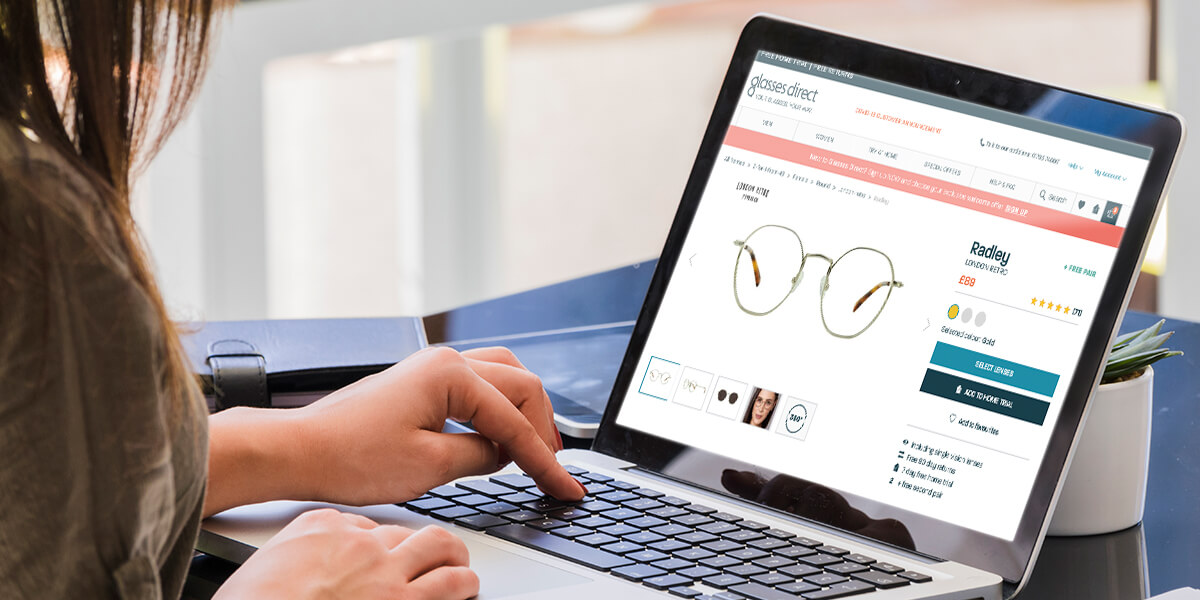 Buying glasses online on a laptop