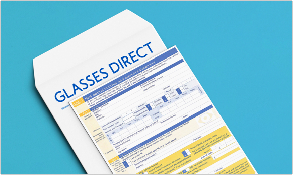 Optical voucher next to a Glasses Direct branded envelope