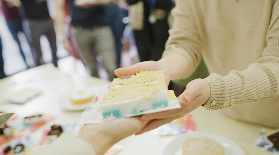 Cake slices being distributed
