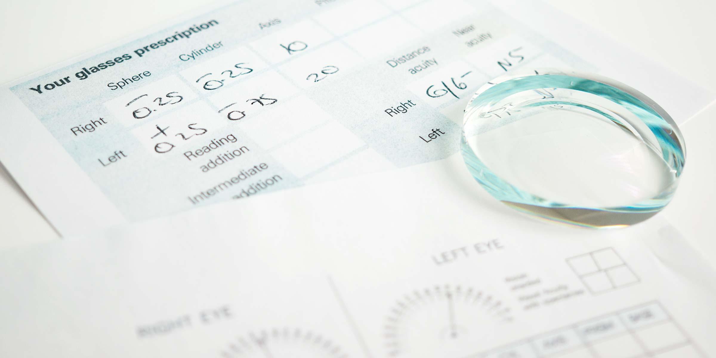 A lens lying on a prescription form