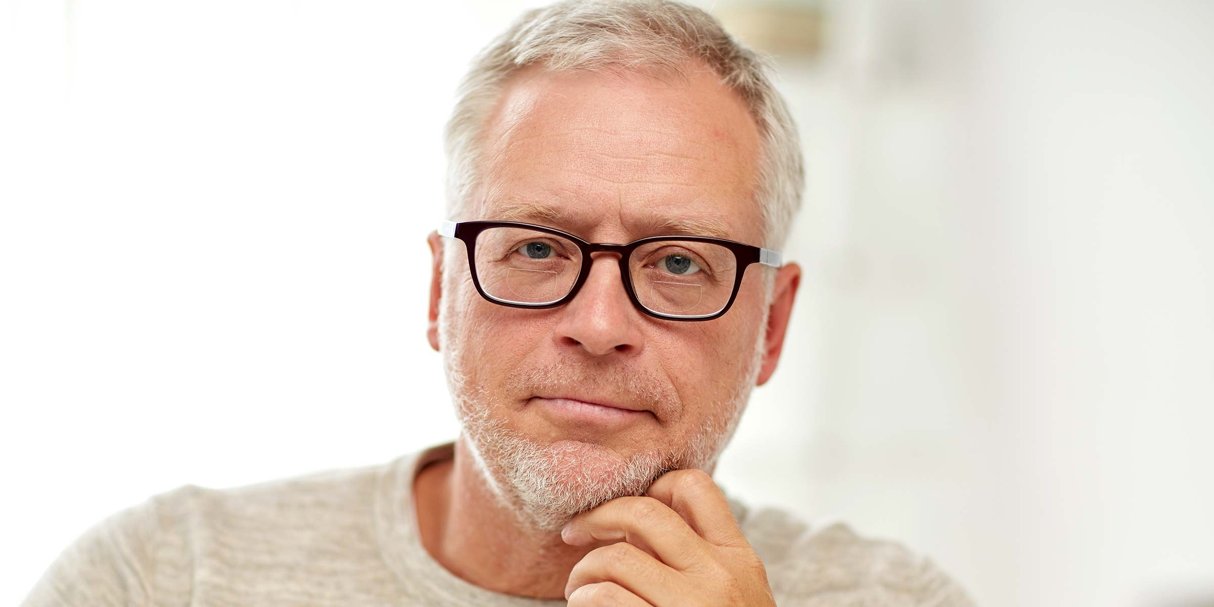 Middle-aged man wearing glasses with bifocal lenses
