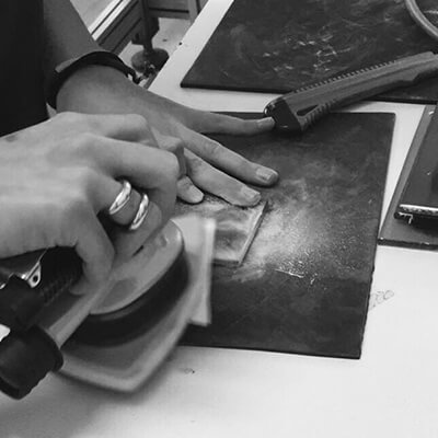 Sheets of acetate being cut into shape