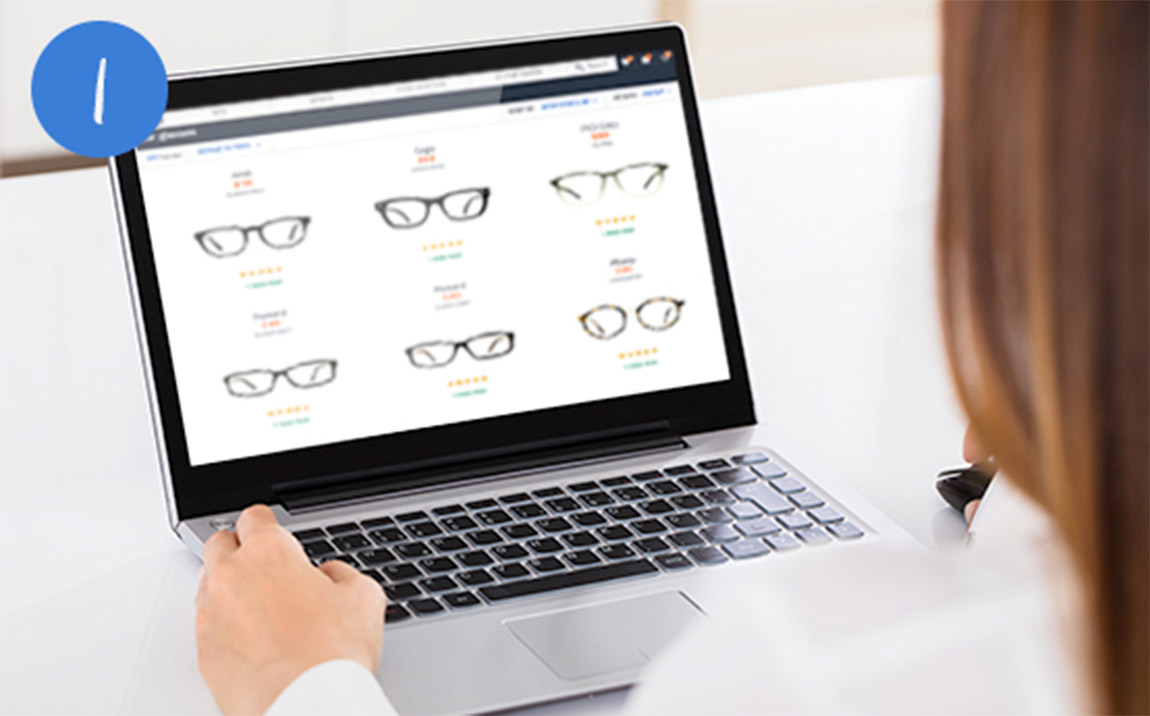 A woman browsing the Glasses Direct website on a laptop