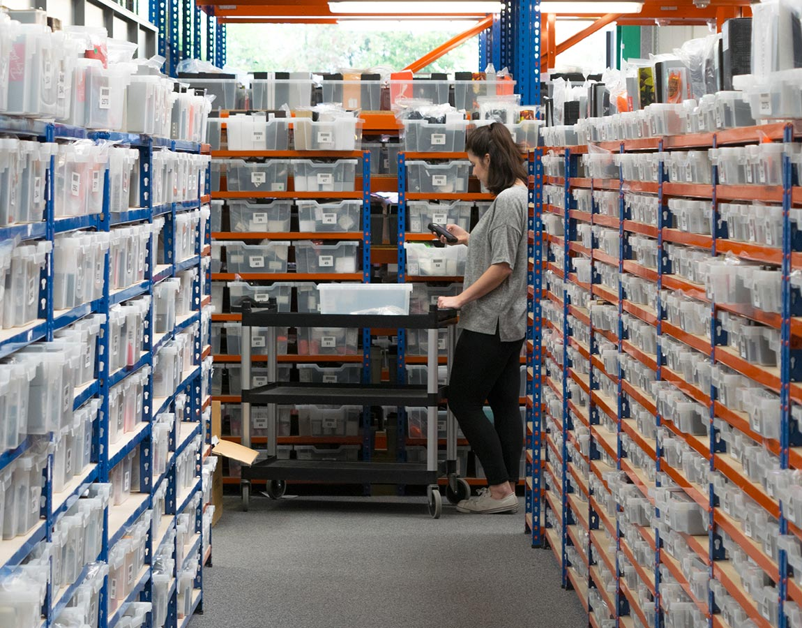 A warehouse worker scanning an item in the Glasses Direct warehouse